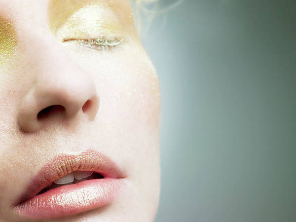 Human Face Photograph - Young Woman With Gold Make Up On Face by Image Source