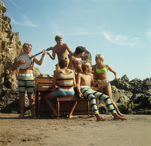 Rock Music Photograph - Young Women And Men Having Fun On Beach by Tom Kelley Archive