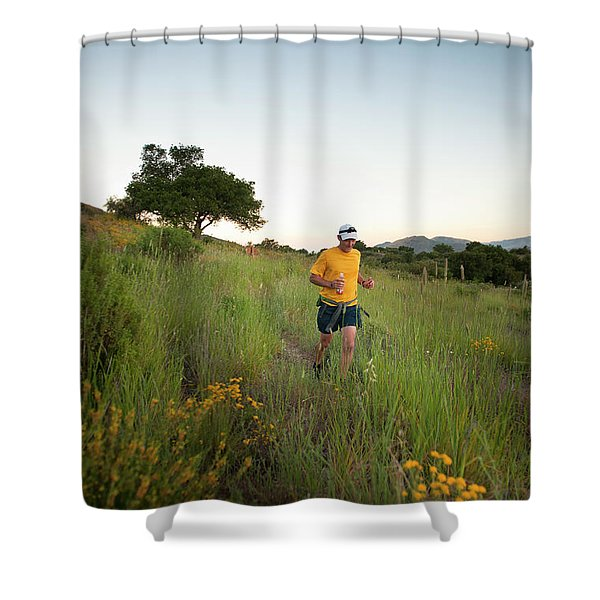 A Trail Runner Passes Wildflowers Shower Curtain