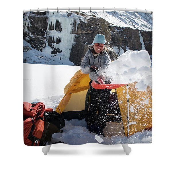 A Woman Shovelling Snow Away Shower Curtain