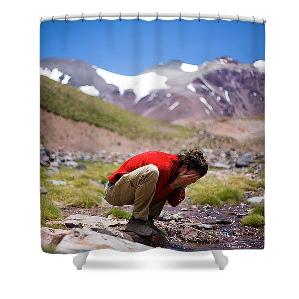 A Young Man Washes His Face In The Icy Shower Curtain