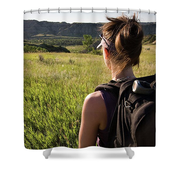 An Adult Woman Backpacks In A National Shower Curtain