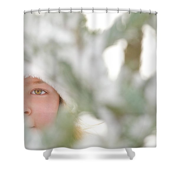 Young Girl Peering Through Snow Covered Shower Curtain