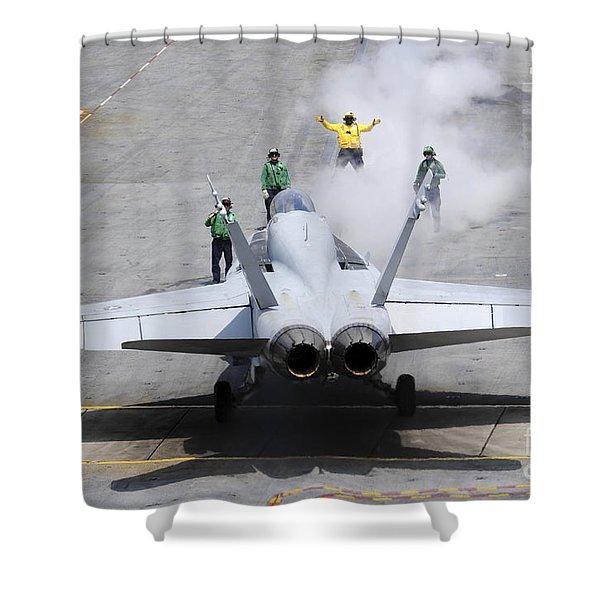 An Aircraft Director Guides An Fa-18 Shower Curtain