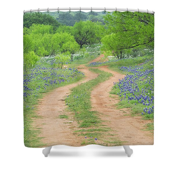 A Dirt Road Lined By Blue Bonnets Of Texas Shower Curtain