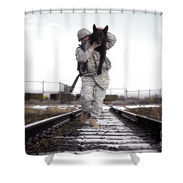 A Military Dog Handler Uses An Shower Curtain