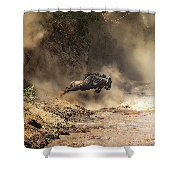 Wildebeest Leaps From The Bank Of The Mara River Shower Curtain