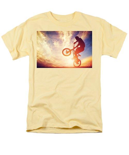 Man Riding A Bmx Bike Performing A Trick Against Sunset Sky Men's T-Shirt  (Regular Fit) by Michal Bednarek