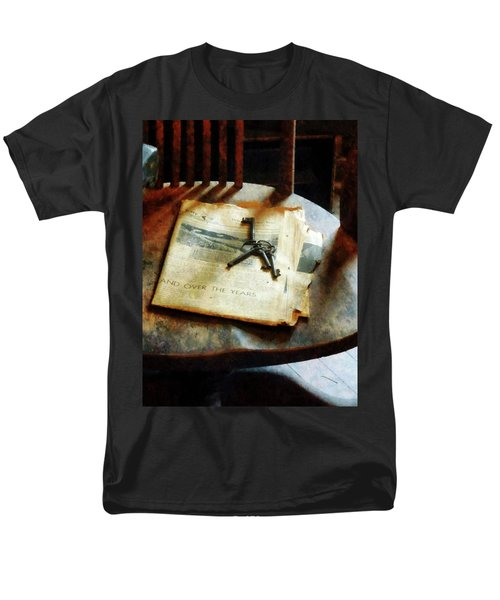 Men's T-Shirt  (Regular Fit) featuring the photograph Antique Keys On Newspaper by Susan Savad