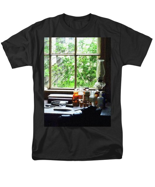 Men's T-Shirt  (Regular Fit) featuring the photograph Doctor - Medicine And Hurricane Lamp by Susan Savad