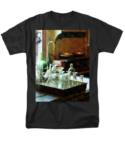 Men's T-Shirt  (Regular Fit) featuring the photograph Pharmacy - Glass Funnels And Bottles by Susan Savad