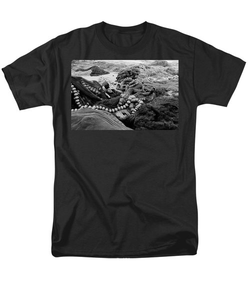 Men's T-Shirt  (Regular Fit) featuring the photograph Fisherman Sleeping On A Huge Array Of Nets by Tom Wurl
