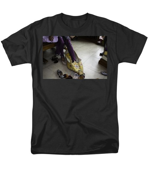 Men's T-Shirt  (Regular Fit) featuring the photograph Trying On A Very Large Decorated Shoe by Ashish Agarwal