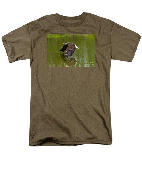 Bald Eagle In Low Flight Over A Lake Men's T-Shirt  (Regular Fit) by Les Palenik