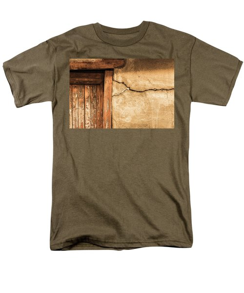 Men's T-Shirt  (Regular Fit) featuring the photograph Cracked Lime Stone Wall And Detail Of An Old Wooden Door by Semmick Photo