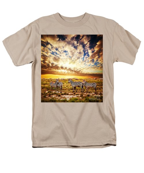 Zebras Herd On African Savanna At Sunset. Men's T-Shirt  (Regular Fit) by Michal Bednarek