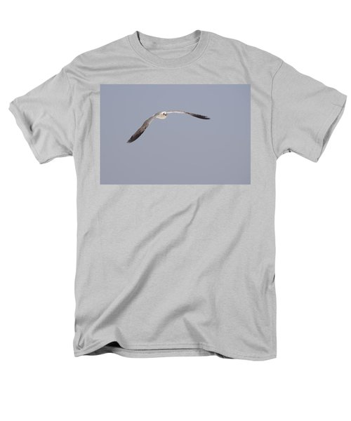 Men's T-Shirt  (Regular Fit) featuring the photograph Seagull In Flight Against A Blue Sky by Charles Beeler