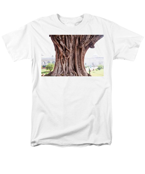 Men's T-Shirt  (Regular Fit) featuring the photograph The Twisted And Gnarled Stump And Stem Of A Large Tree Inside The Qutub Minar Compound by Ashish Agarwal