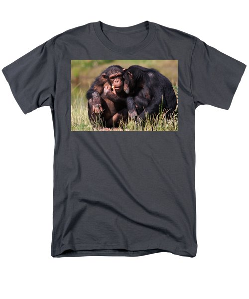 Men's T-Shirt  (Regular Fit) featuring the photograph Chimpanzees Eating A Carrot by Nick  Biemans