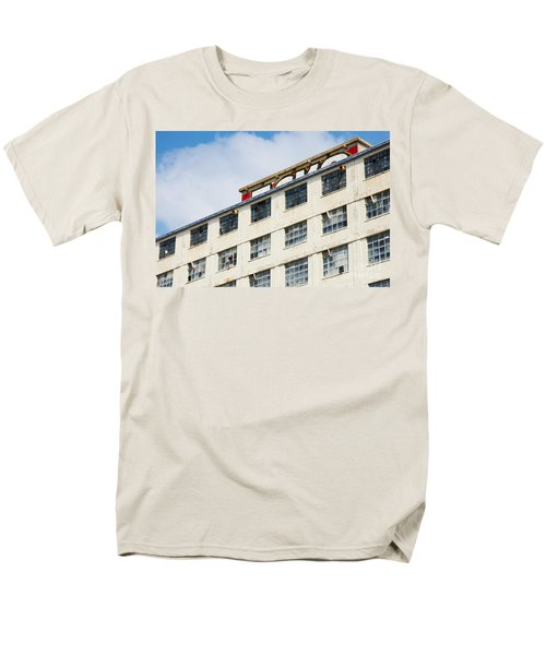 Men's T-Shirt  (Regular Fit) featuring the photograph Old Factory Under A Clear Blue Sky by Nick  Biemans