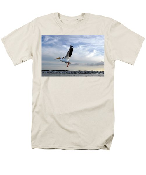 Men's T-Shirt  (Regular Fit) featuring the photograph White Pelican Flying Over Island by Dan Friend