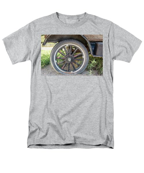Men's T-Shirt  (Regular Fit) featuring the photograph Old Truck Tire In Rural Rocky Mountain Town by Peter Ciro