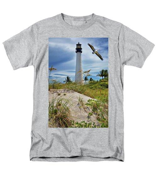 Pelican Flying Over Cape Florida Lighthouse Men's T-Shirt  (Regular Fit) by Justin Kelefas