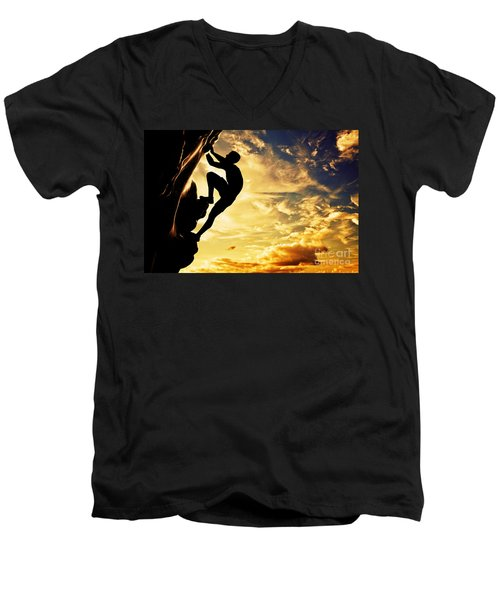 A Silhouette Of Man Free Climbing On Rock Mountain At Sunset Men's V-Neck T-Shirt