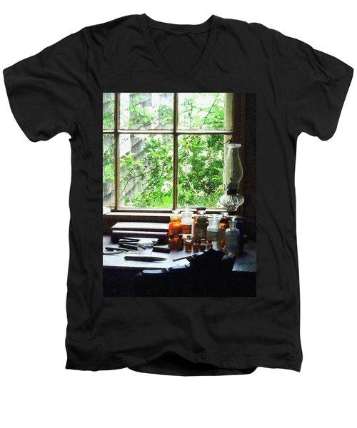 Doctor - Medicine And Hurricane Lamp Men's V-Neck T-Shirt by Susan Savad