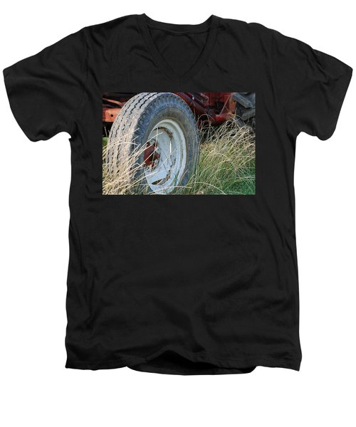 Men's V-Neck T-Shirt featuring the photograph Ford Tractor Tire by Jennifer Ancker