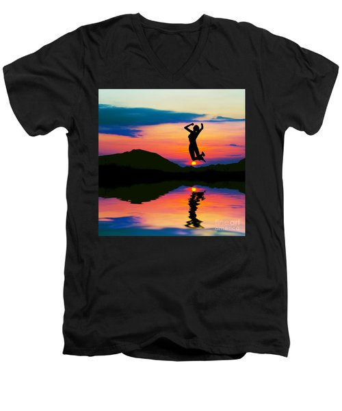 Silhouette Of Happy Woman Jumping At Sunset Men's V-Neck T-Shirt by Michal Bednarek