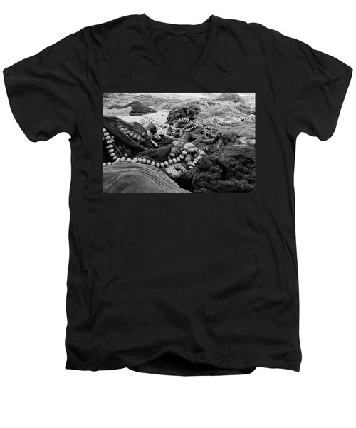 Men's V-Neck T-Shirt featuring the photograph Fisherman Sleeping On A Huge Array Of Nets by Tom Wurl