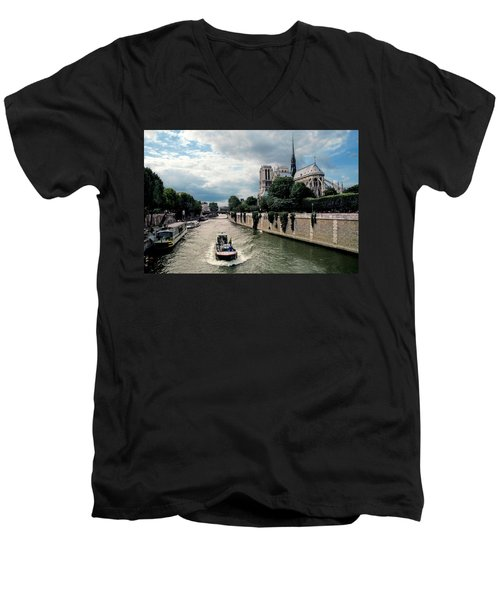Men's V-Neck T-Shirt featuring the photograph Tour Boat Passing Notre Dame by Dave Mills