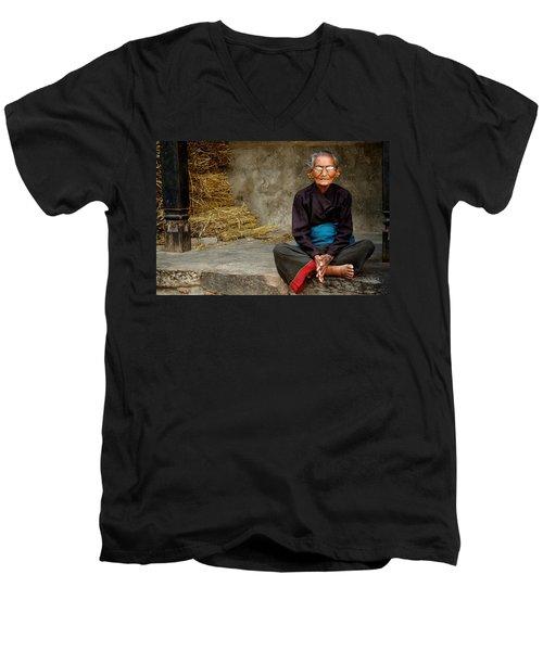 An Old Woman In Bhaktapur Men's V-Neck T-Shirt by Valerie Rosen