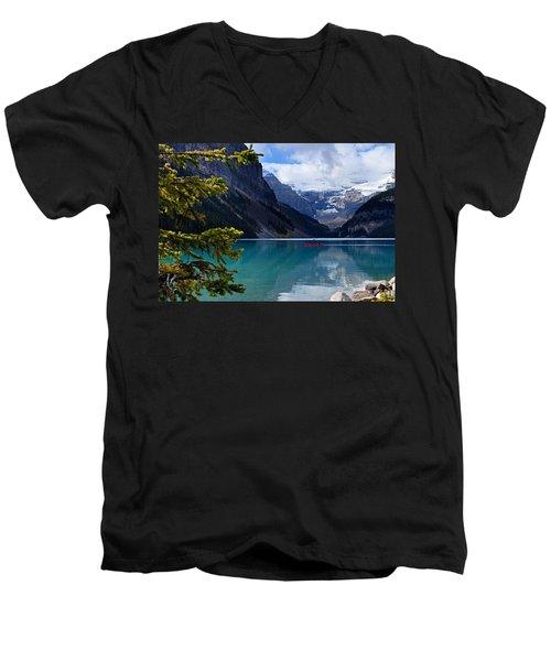 Canoe On Lake Louise Men's V-Neck T-Shirt by Larry Ricker