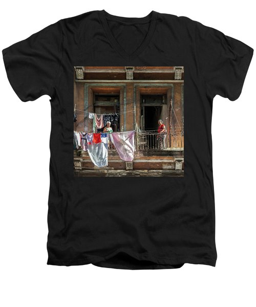 Men's V-Neck T-Shirt featuring the photograph Cuban Women Hanging Laundry In Havana Cuba by Charles Harden
