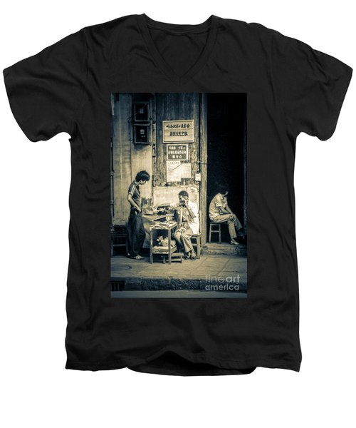 Men's V-Neck T-Shirt featuring the photograph Phonecall On Chinese Street by Heiko Koehrer-Wagner