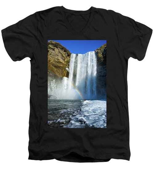 Men's V-Neck T-Shirt featuring the photograph Skogafoss Waterfall Iceland In Winter by Matthias Hauser