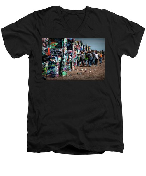 Men's V-Neck T-Shirt featuring the photograph Spray Paint Fun At Cadillac Ranch by Randall Nyhof