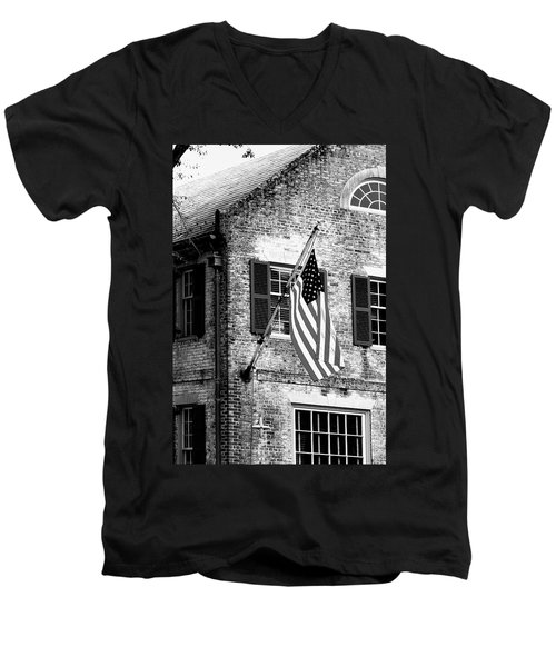 Men's V-Neck T-Shirt featuring the photograph Us Flag In Colonial Williamsbug by Emanuel Tanjala