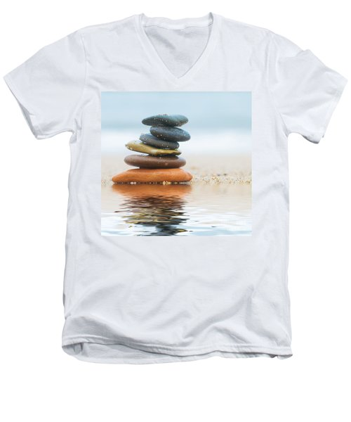Stack Of Beach Stones On Sand Men's V-Neck T-Shirt by Michal Bednarek
