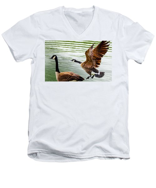 Men's V-Neck T-Shirt featuring the photograph A Pair Of Canada Geese Landing On Rockland Lake by Jerry Cowart