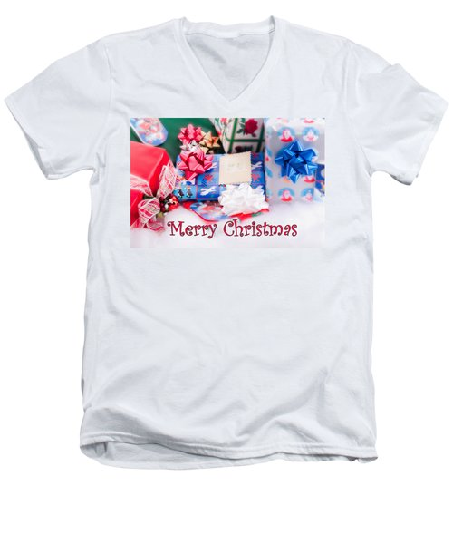 Men's V-Neck T-Shirt featuring the photograph Christmas Presents On Artificial Snow by Vizual Studio