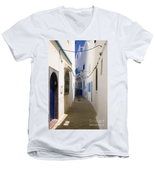 Men's V-Neck T-Shirt featuring the photograph Narrow Backstreet In The Medina Of Asilah On Northwest Tip Of Atlantic Coast Of Morocco by Ralph A  Ledergerber-Photography