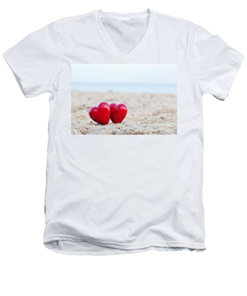 Two Red Hearts On The Beach Symbolizing Love Men's V-Neck T-Shirt