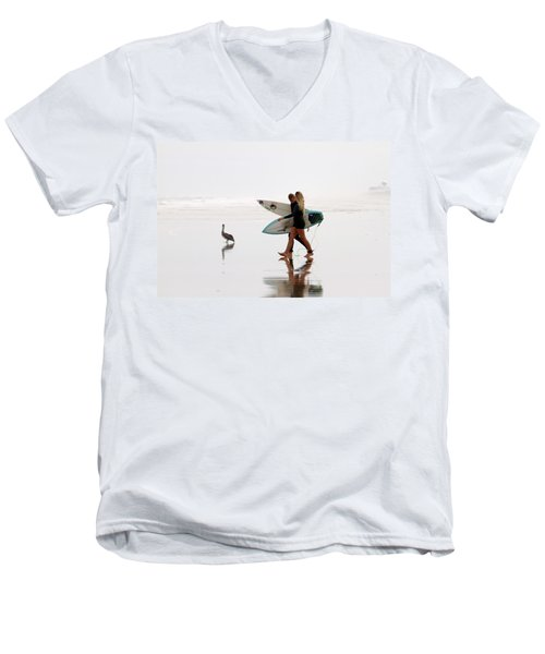 Men's V-Neck T-Shirt featuring the photograph Surfers And A Pelican by Alice Gipson