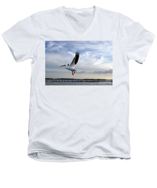 Men's V-Neck T-Shirt featuring the photograph White Pelican Flying Over Island by Dan Friend