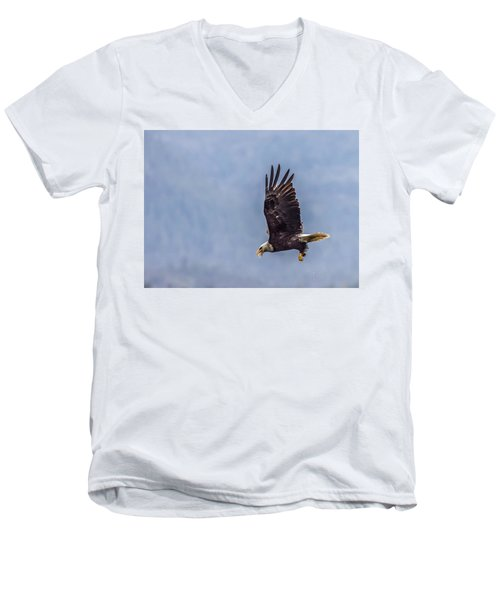 Men's V-Neck T-Shirt featuring the photograph Flying With His Mouth Full.  by Timothy Latta