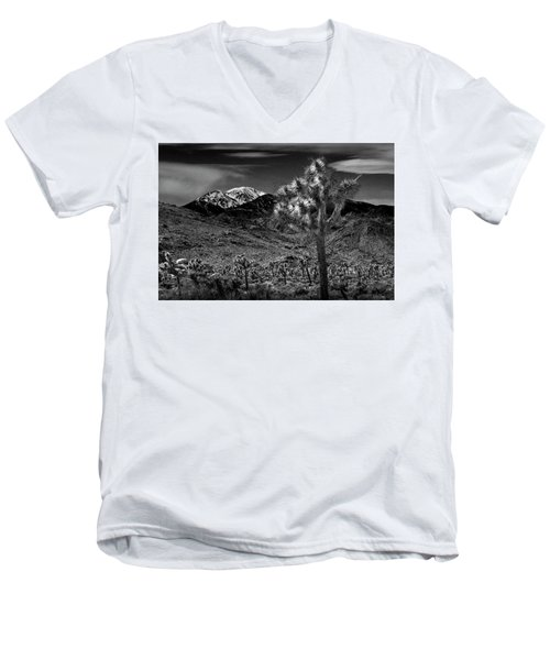 Men's V-Neck T-Shirt featuring the photograph Joshua Tree In Black And White In Joshua Park National Park With The Little San Bernardino Mountains by Randall Nyhof