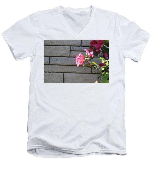 Pink Rose Against Grey Bricks Men's V-Neck T-Shirt by Michele Wilson